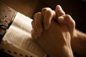 Praying-Hands-over-Bible